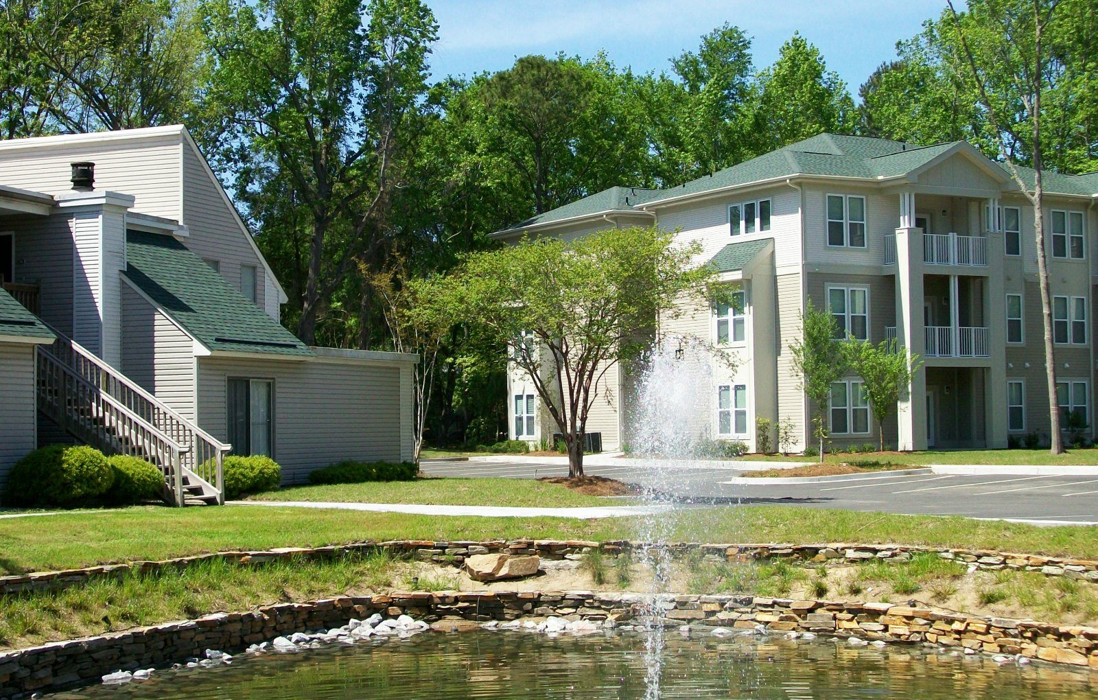 pond and exterior at Windjammer Apartments in Charleston SC