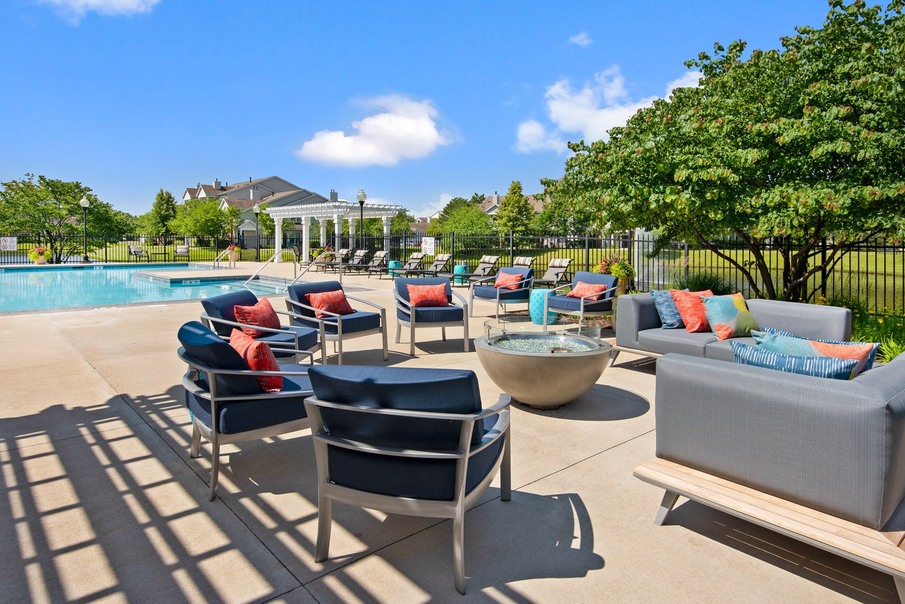 Outdoor swimming pool with poolside seating
