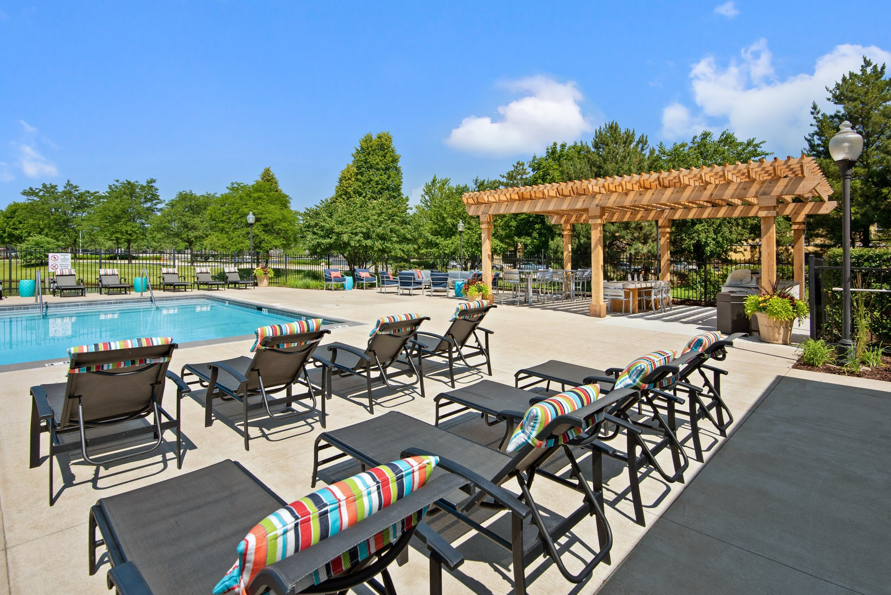 Outdoor swimming pool with poolside lounge chairs