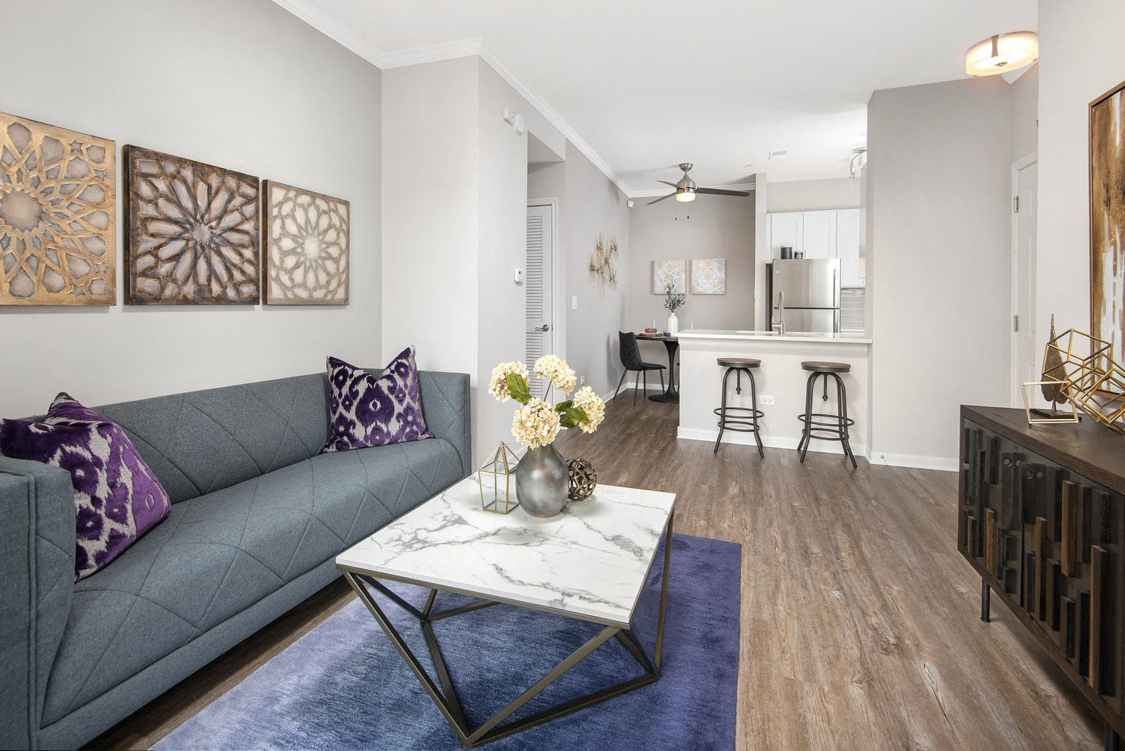 Open concept living area with sofa and coffee table