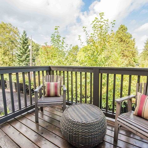 Balcony with view of trees Latitude Apt Rentals Happy Valley OR