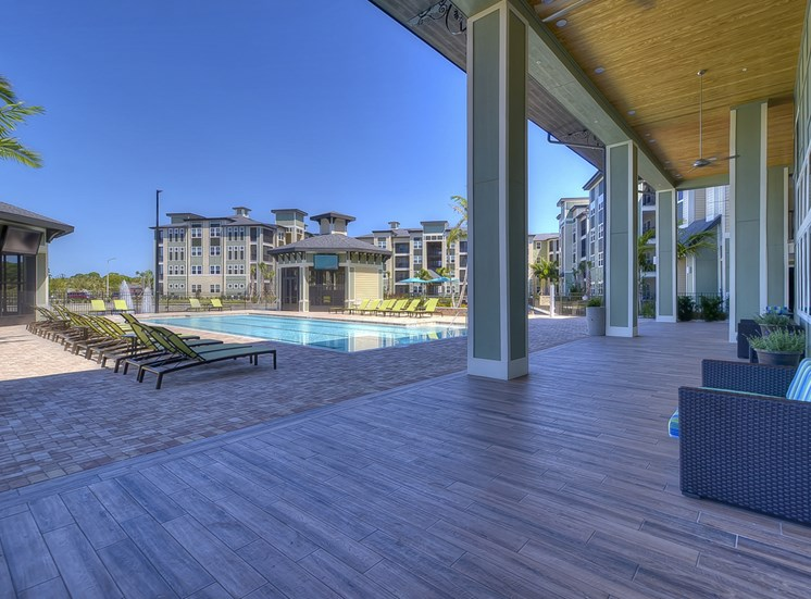 Charleston on 66th Apartments Poolside Lounge Area