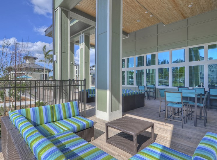 Charleston on 66th Apartments Poolside Lounge Area | Largo, FL