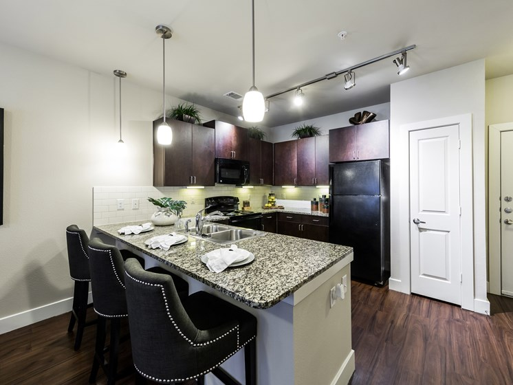 Modular Kitchen with Separate Breakfast Bar at Grand at the Dominion, San Antonio, TX 78257