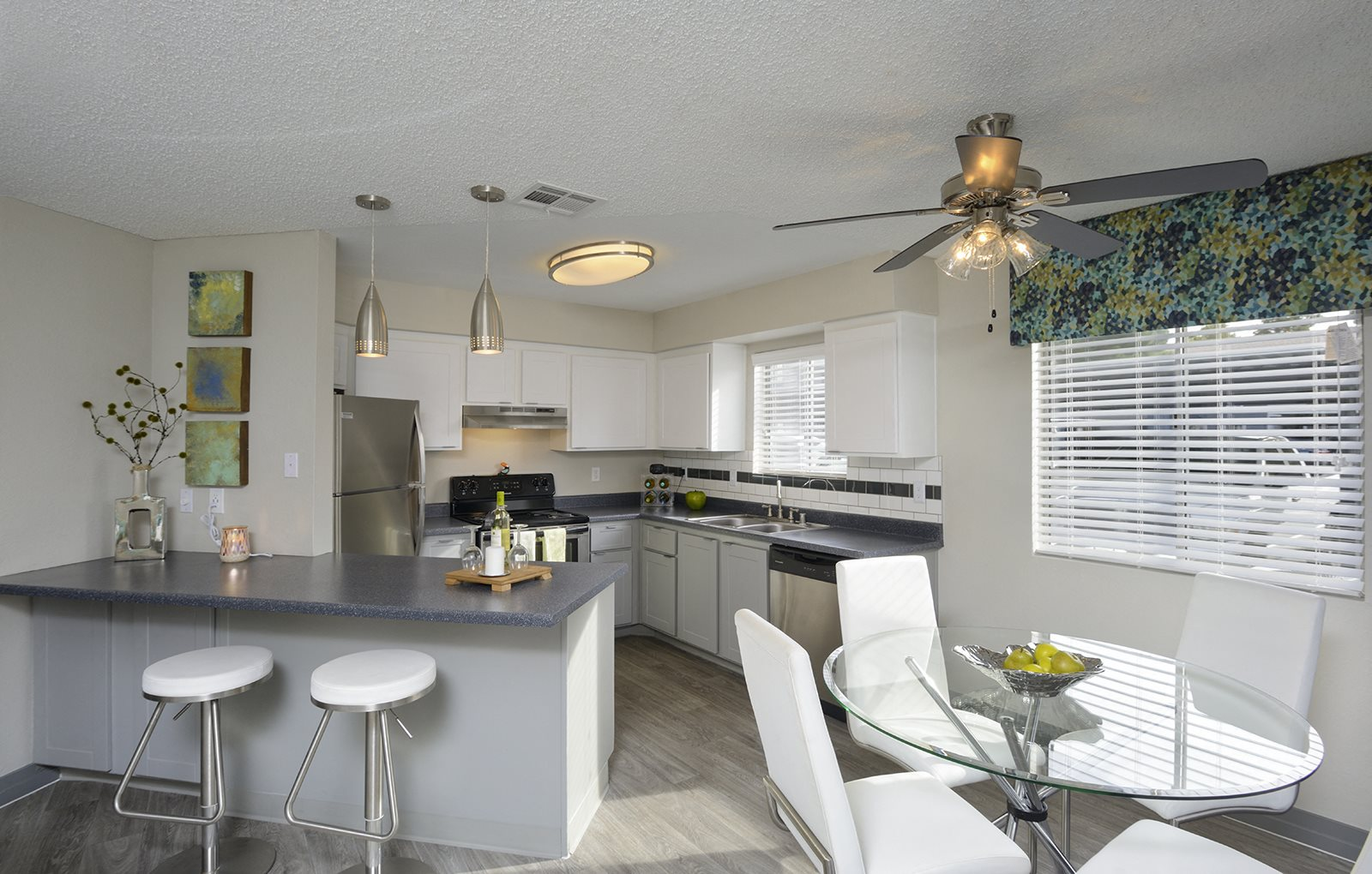 Kitchen with White Cabinetry and Appliances, at The Bristol at Sunset, Henderson, NV