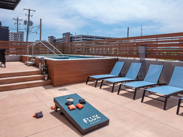 Cornhole and Hot Tub at Flux Apartments Des Moines IA