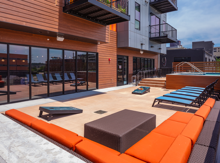 Courtyard and Cornhole at Flux Apartments Des Moines IA