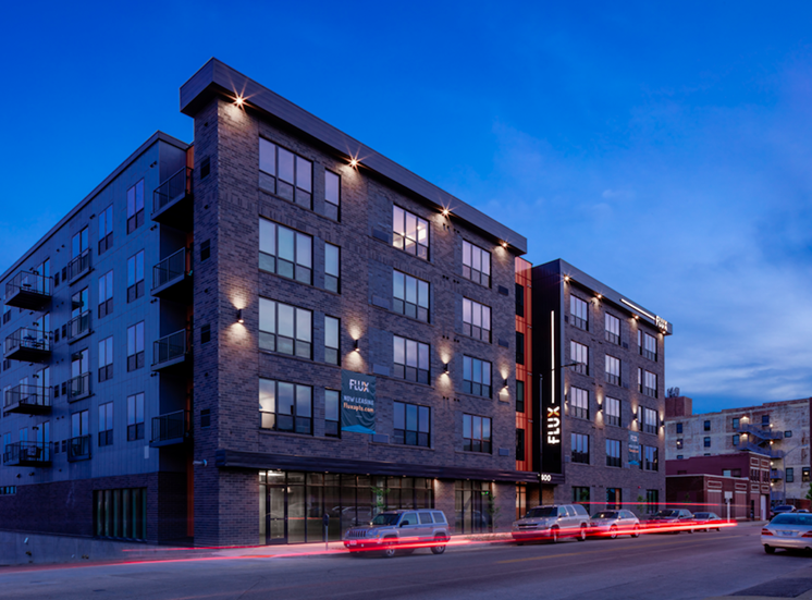 Exterior View at Night of Flux Apartments Des Moines IA