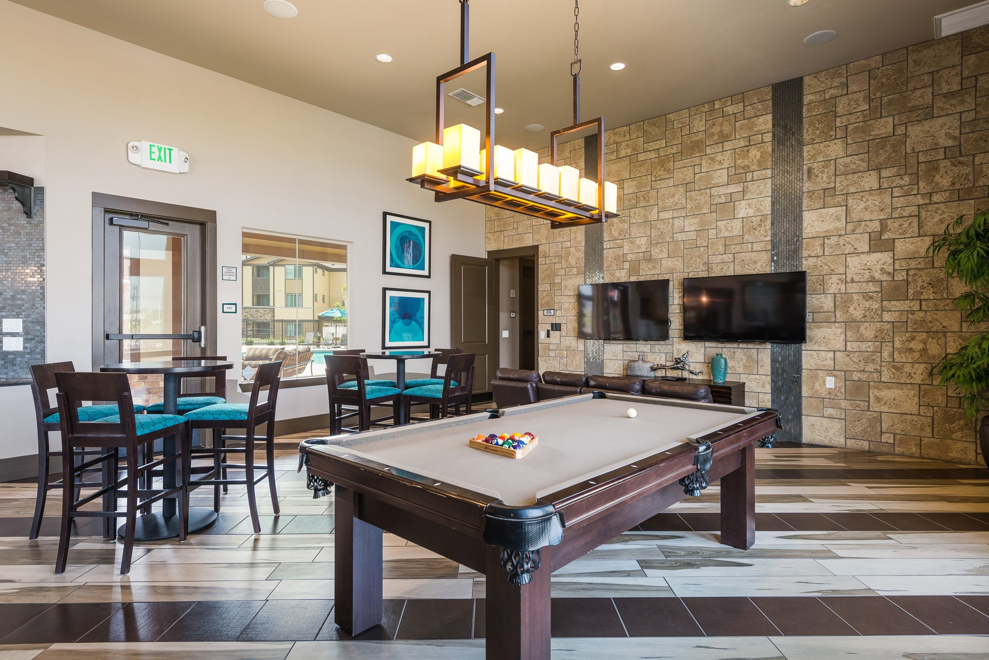 Billiards at Estate at Woodmen Ridge Apartments in Colorado Springs, CO