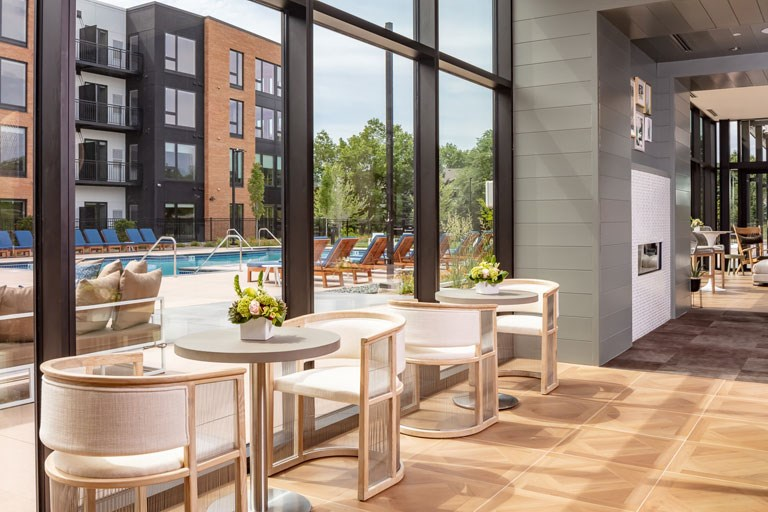 The Loden Apartments Lifestyle - Clubhouse Tables