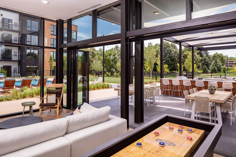 The Loden Apartments Lifestyle - Shuffle Board & Outdoor Bar Seating