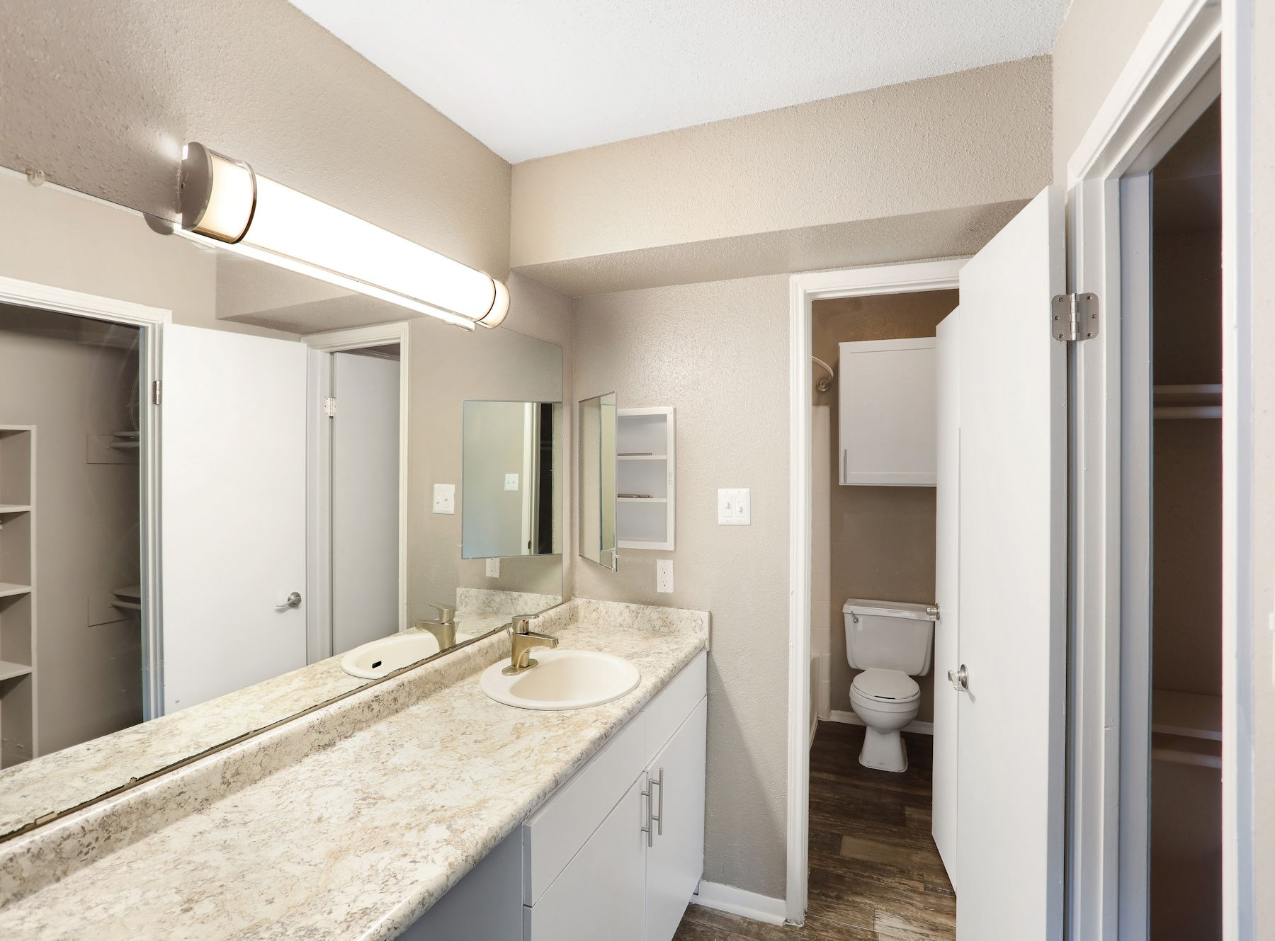 Model Bathroom with Large Mirror