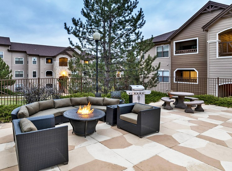 Grand Centennial Apartments fire pit with seating area