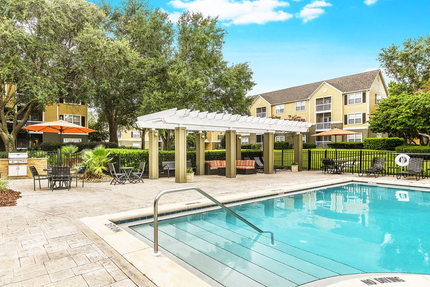 The Colony at Deerwood Apartments resort-style swimming pool with lounge area