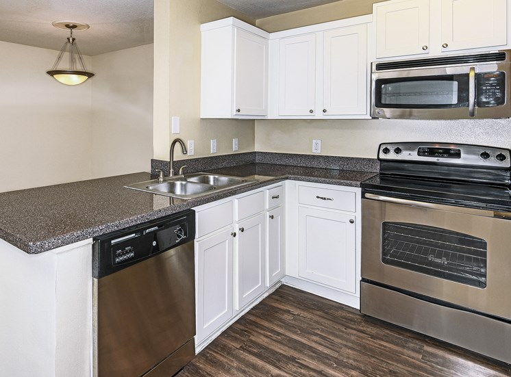 The Colony at Deerwood Apartments fully-equipped kitchen with stainless steel appliances available