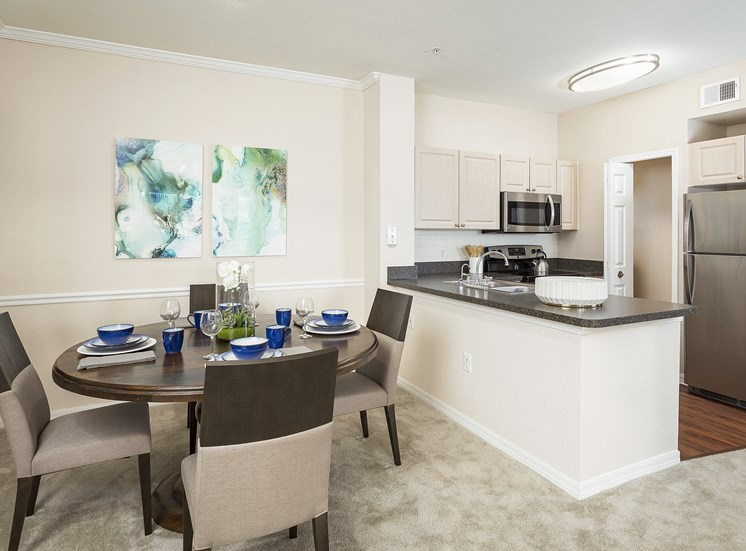 Addison Park at Cross Creek Apartments - Staged dining area and kitchen