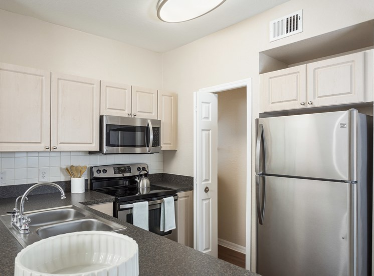 Addison Park at Cross Creek Apartments - Stainless steel appliances