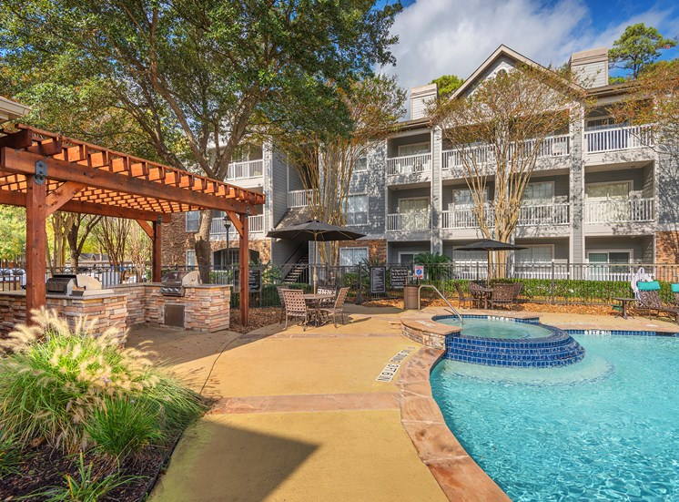 Lodge at Cypresswood Apartments - Spa with nearby BBQ grills