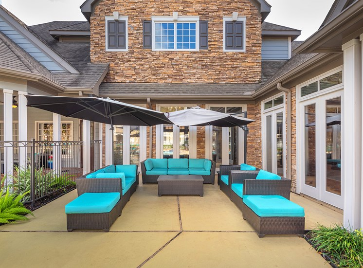 Lodge at Cypresswood Apartments - Poolside lounge