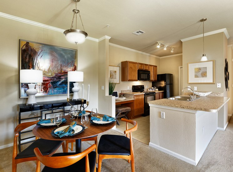 Cordillera Ranch Apartments - Chef kitchen with black Whirlpool appliances