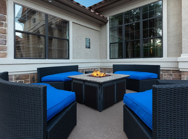 DeLayne at Twin Creeks fire pit with seating