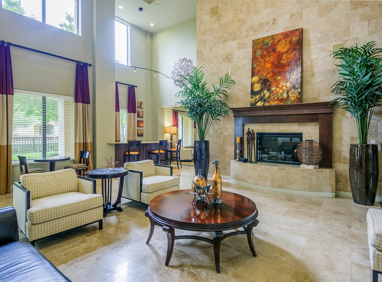 Monterra Las Colinas Apartments clubhouse with indoor fireplace