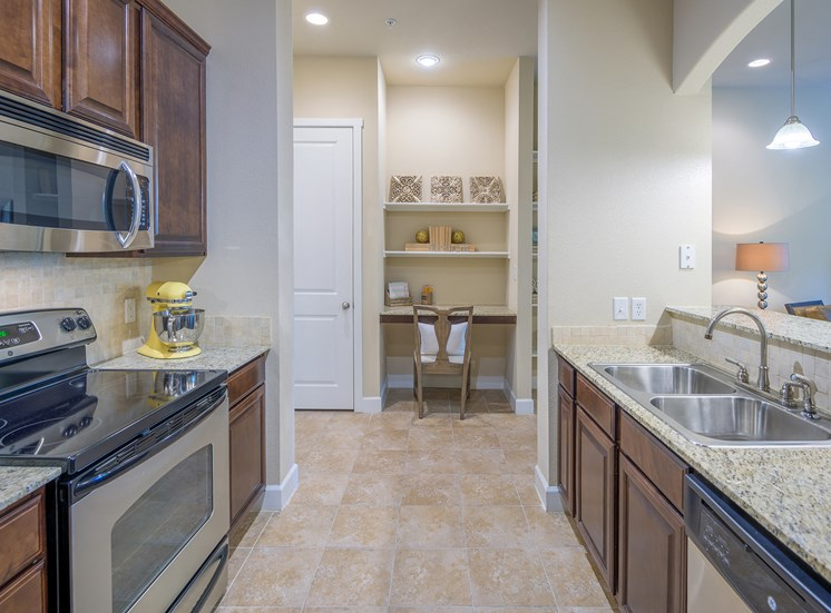 Monterra Las Colinas Apartments kitchens with stainless steel appliances and solid wood cabinets