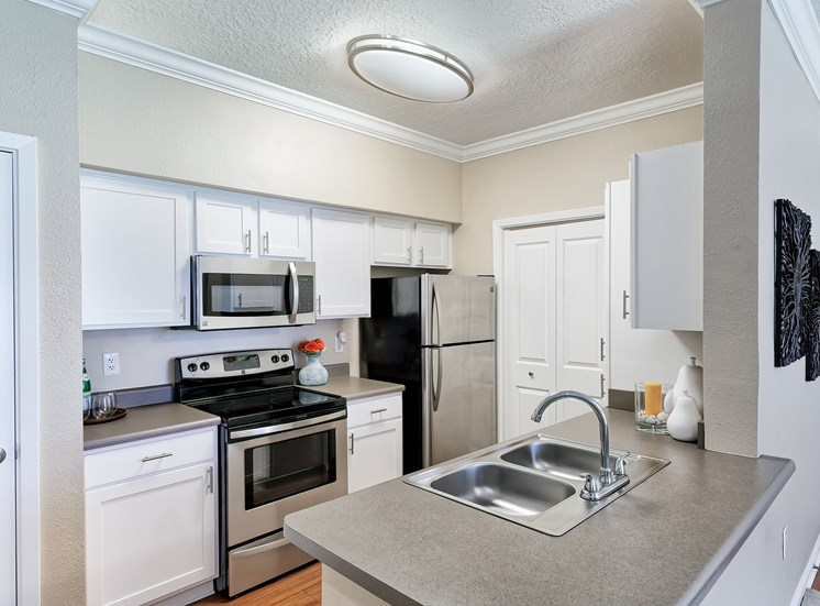 Weston Point Apartments - Fully-equipped kitchen with above range microwaves and refrigerators with icemakers