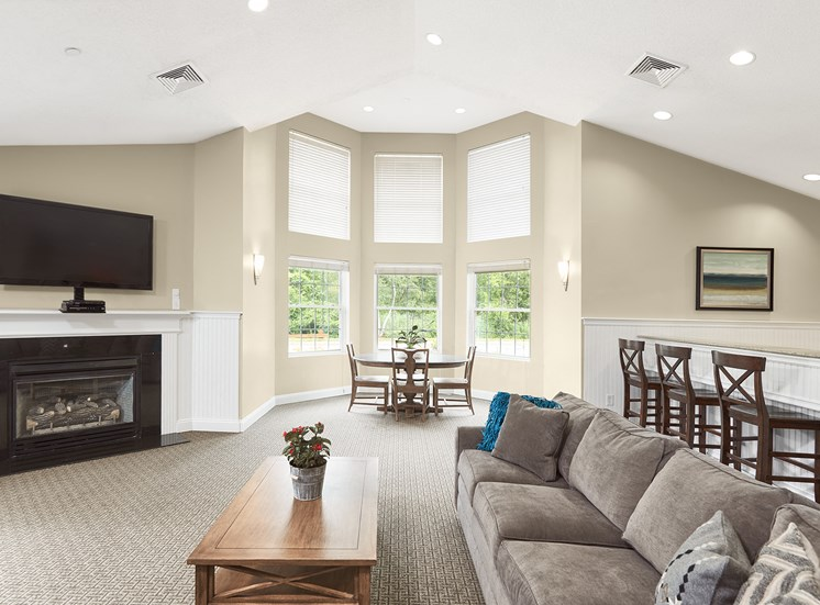 Hampshire Green Apartments - Resident clubhouse with fireplace lounge