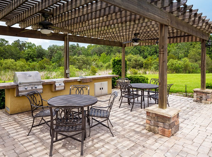 Delano at Cypress Creek grilling station with seating