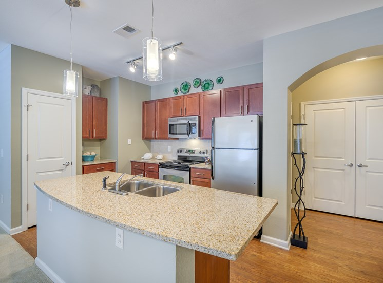 Windward Long Point Apartments well-appointed kitchens with granite countertops