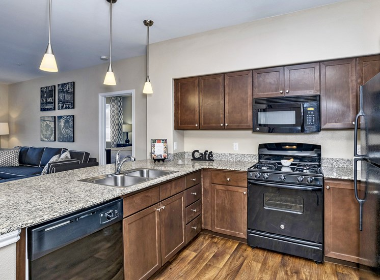 First and Main Apartments gourmet kitchen with granite countertops