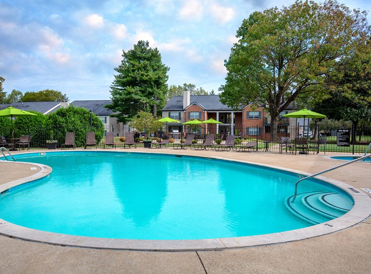 Littlestone of Village Green Apartments - Poolside sundeck with spa