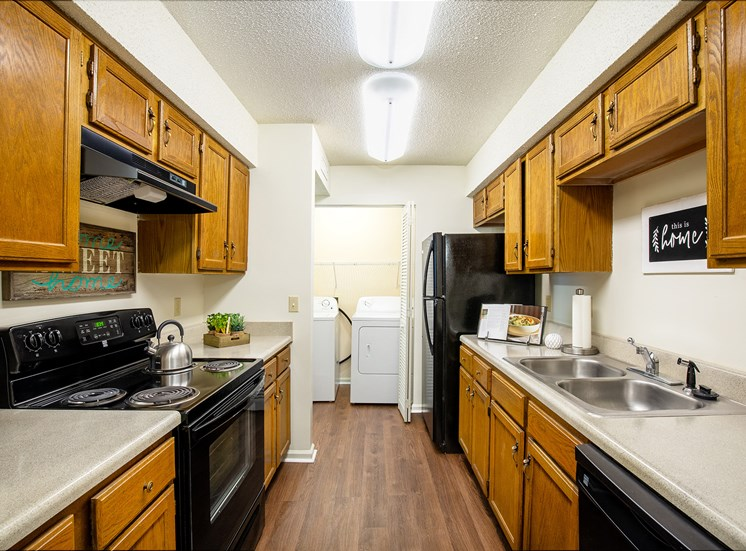 Littlestone of Village Green Apartments - Kitchens with black appliances in select units