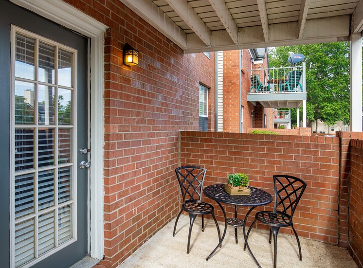 Littlestone of Village Green Apartments - Private patios on ground level