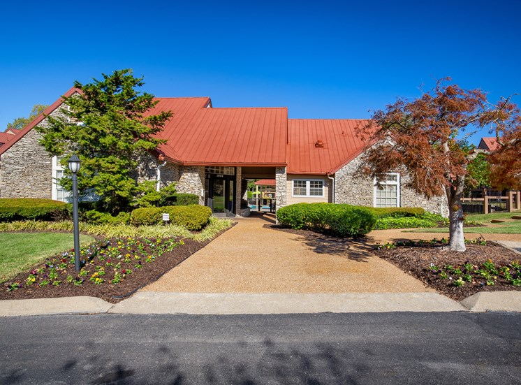 Oakwell Farms Apartments - Exterior building with landscaped pathways
