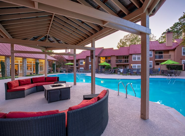Oakwell Farms Apartments - Poolside fire pit with seating