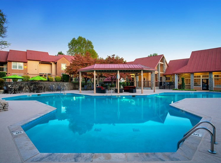Oakwell Farms Apartments - Resort-style pool at twilight