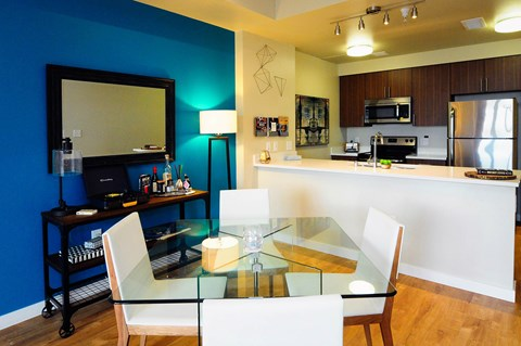 Dining and kitchen area with stainless steel appliances