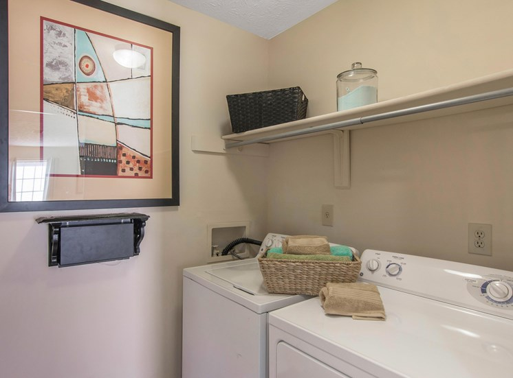 Dunwoody Village Laundry Room with Washer Dryer and Shelving