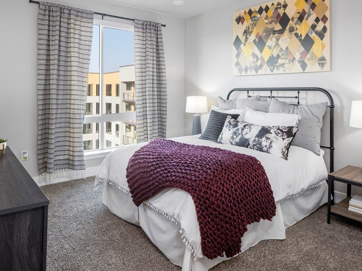 Comfortable bedrooms with plush carpeting and gorgeous views at Baseline 158 in Beaverton, OR