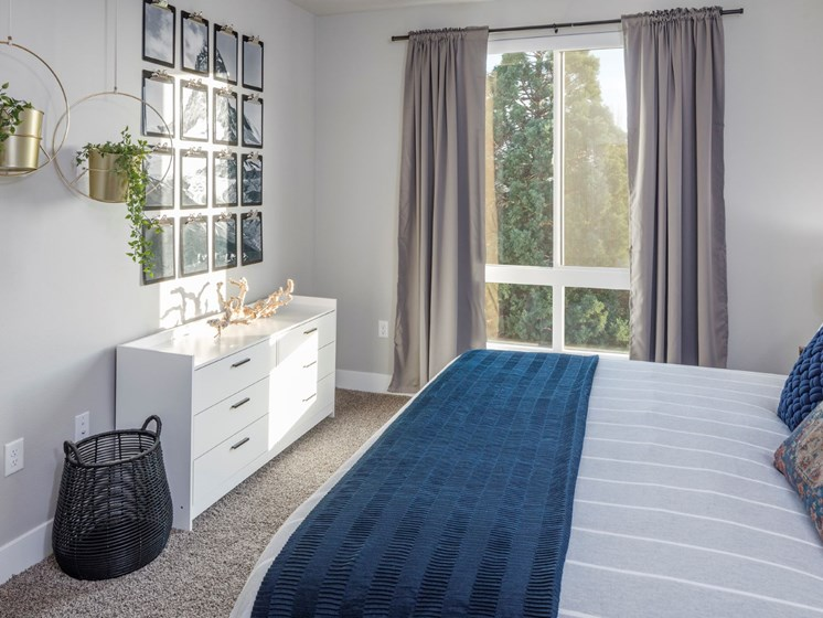 Large windows and beautiful views from the bedrooms at Baseline 158 apartments in Beaverton, 97006