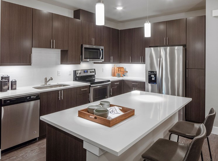 Stainless-steel appliances and gourmet kitchen islands at Baseline 158 in Oregon