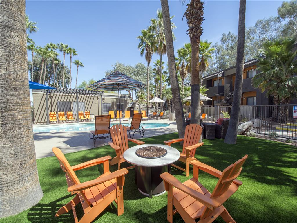 Adirondack chairs around a firepit as a community amenity at Palm Canyon, Tucson, 85741