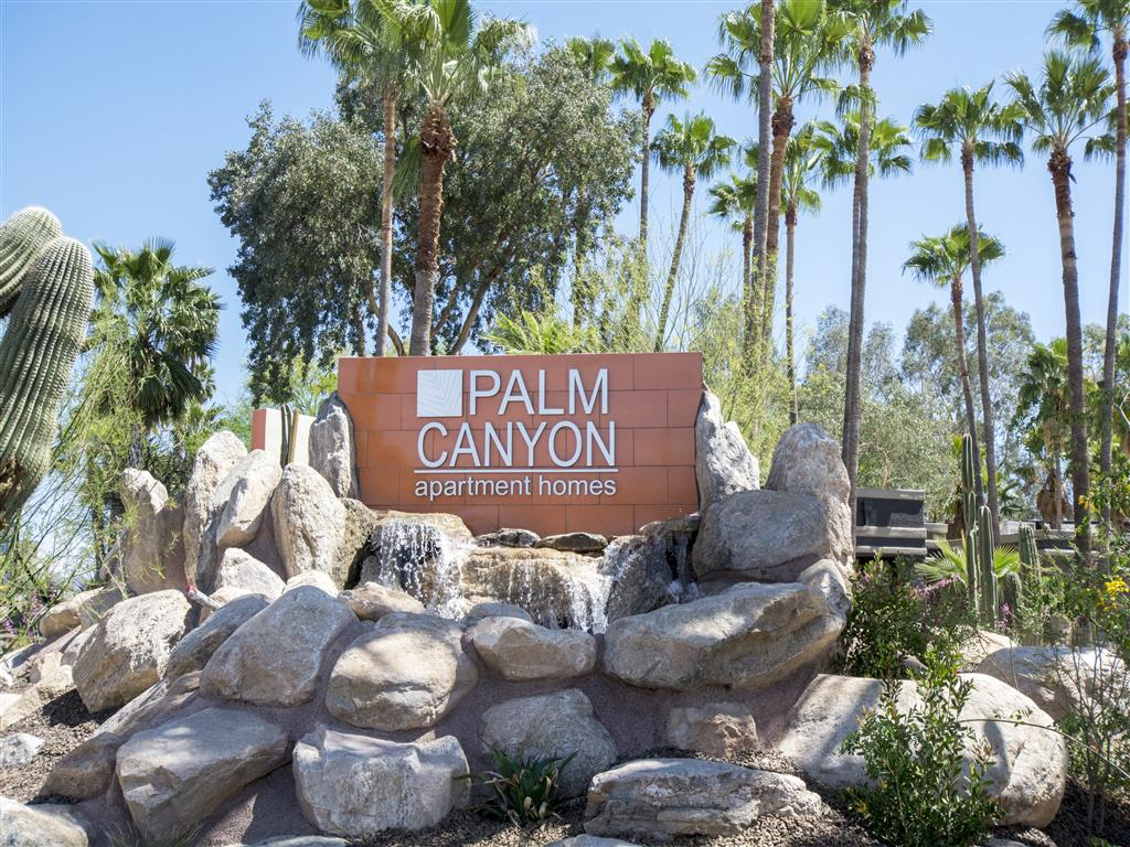 Palm Canyon's welcome sign with fountain and palm trees at Palm Canyon, Tucson