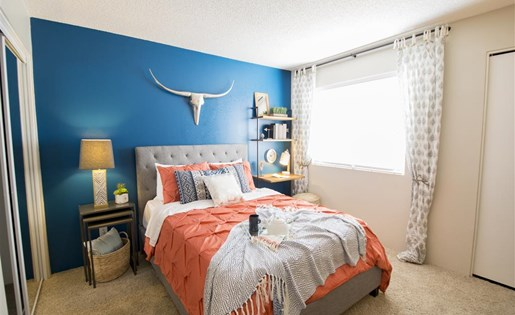 Southwest themed decor in our brightly lit model bedroom at Palm Canyon, Tucson, 85741