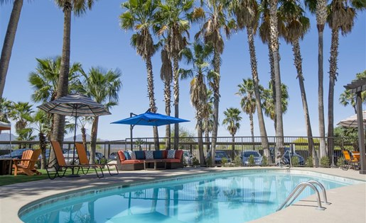 Swim year-round in our sparkling heated pool at Palm Canyon, Tucson, AZ