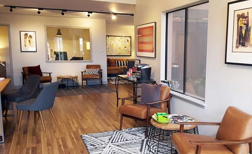 Leasing office lounge with wood inspired flooring at Palm Canyon, Tucson, AZ