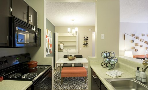Renovated galley style kitchen with modern cabinetry and appliances at Palm Canyon, Tucson, AZ 85741