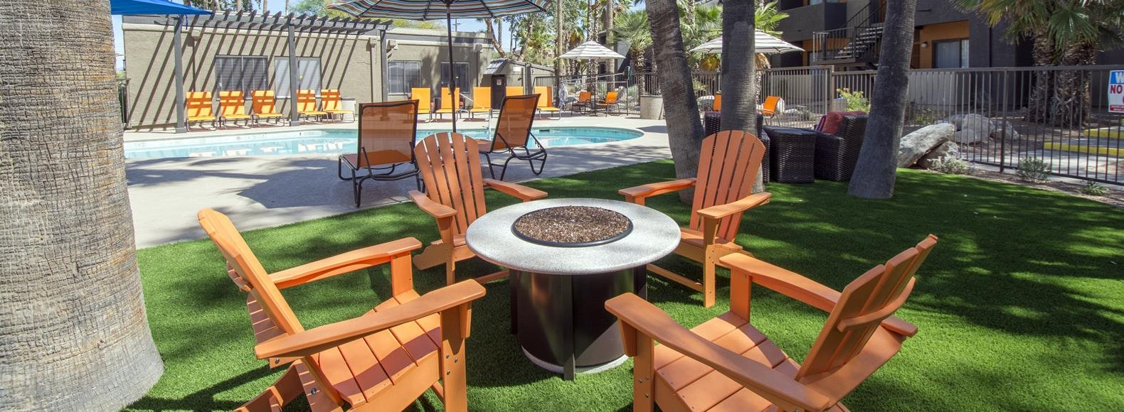 Our outdoor lounge with Adirondack chairs for community residents at Palm Canyon, Tucson, AZ 85741